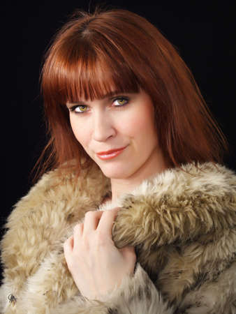 factitious: ginger-haired woman with factitious fur coat