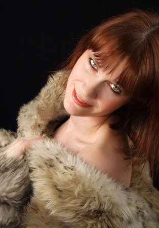 ginger-haired woman with factitious fur coat