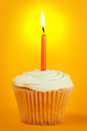 homemade cupcakes with icing and candle Imagens
