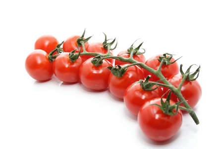 cluster of small tomatoes isolated on white