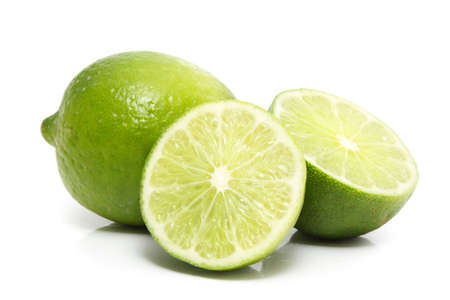 fresh lime on yellow background Imagens