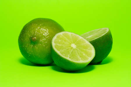 savour: fresh lime on green background Stock Photo
