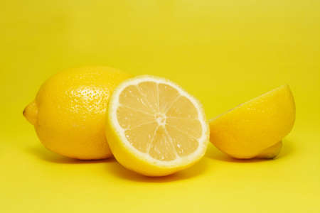 fresh lemon on yellow background