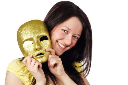 dentition: bella ragazza in possesso di un maschera d'oro, isolata su bianco  Archivio Fotografico