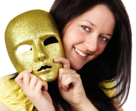 dentition: nice girl holding a gold mask, isolated on white