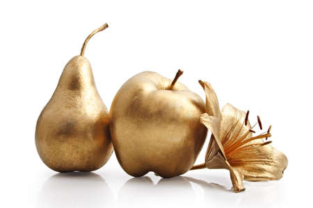gold apple, pear and flower on white