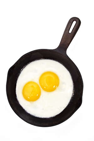 sunny side-up egg on a black cast iron pan