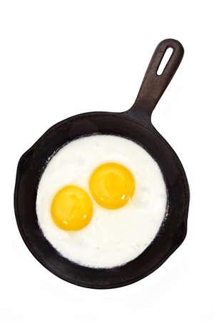 sunny side-up egg on a black cast iron pan
