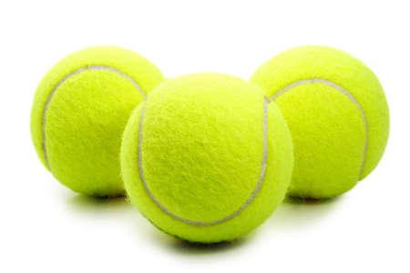 three yellow tennis ball