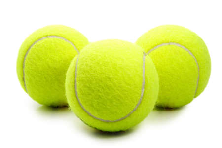 three yellow tennis ball