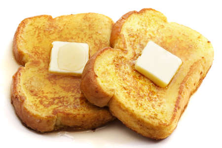 french toast with piece of butter, isolated on white Stock Photo