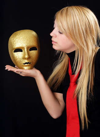 blond teen girl with gold mask, black background