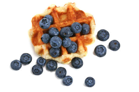 Belgian waffles with fresh blueberries, isolated on white