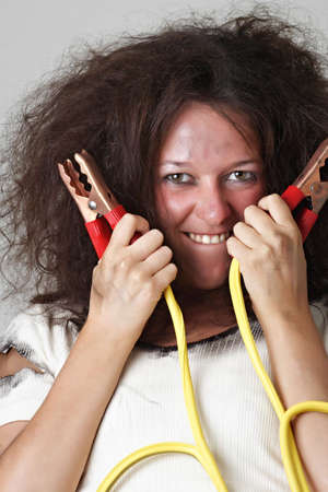theatrical image of woman with booster cable Banco de Imagens