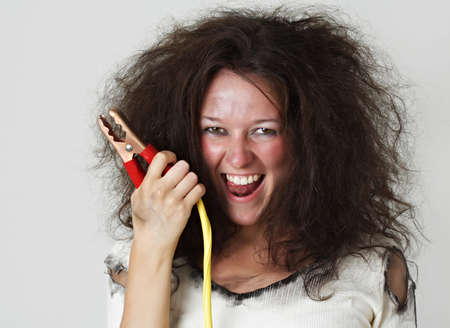 booster: theatrical image of woman with booster cable Stock Photo