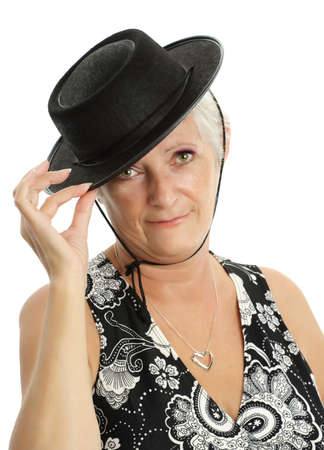 mature white hair woman with black hat Stock Photo