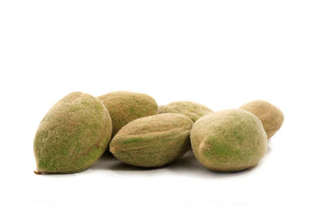 green fresh raw almond with leaves, isolated on white Stok Fotoğraf