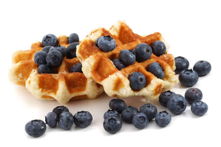 two belgian waffles and fresh blueberries, white background