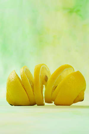 sliced fresh lemon, green background