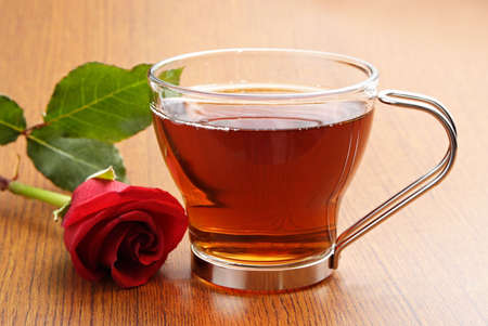 cup: cup of tea with a red rose Stock Photo