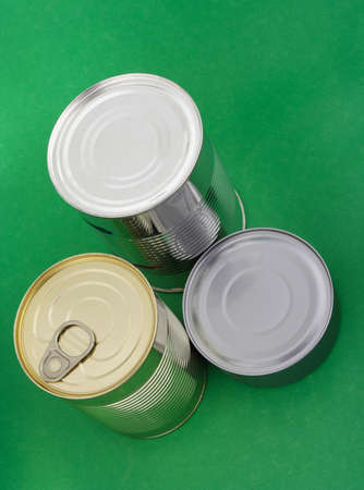 Three different food can, green background