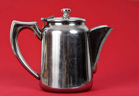 old stainless teapot, red background 版權商用圖片