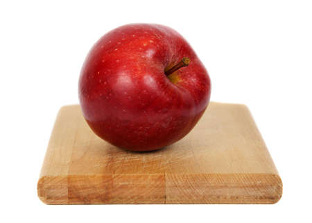 red apple on wood cutting plank Stock Photo - 3608371