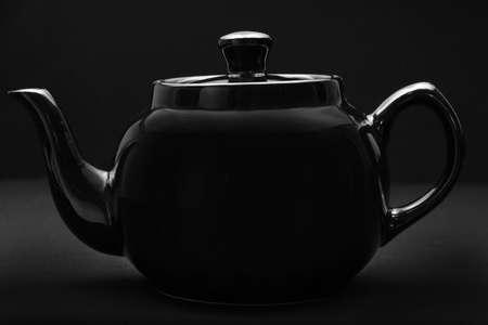 black ceramic teapot over black