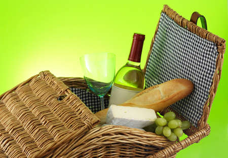 closeup on picnic basket filled with food and wine