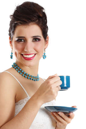 portrait of a young caucasian woman holding a blue cup photo