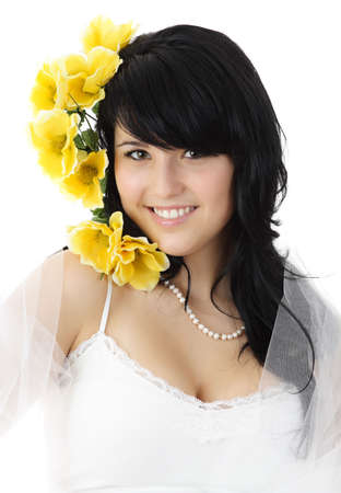 fake smile: young woman with tulle and yellow fake flowers