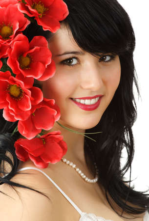 fake smile: young woman with red fake flowers Stock Photo