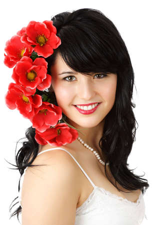 fake smile: beautiful young woman with red fake flowers Stock Photo