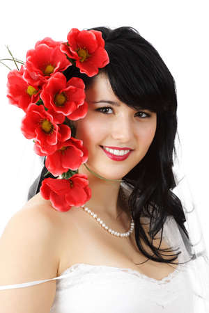 fake smile: portrait of a beautiful young woman with fake flowers on hair