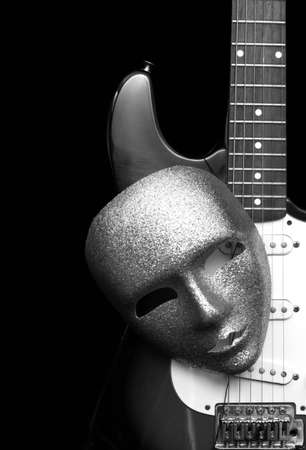 black and white image of electric guitar and mask