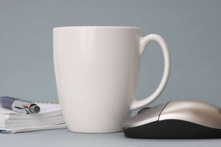 cup of coffee with agenda and computer mouse