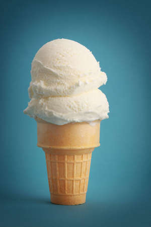 vanilla ice cream cone, blue background