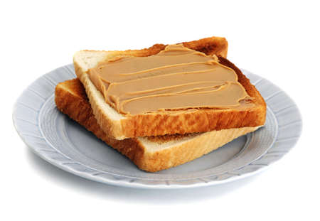 peanut butter toast in blue plate, white background