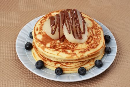 pancakes with bleuberries, pear and chocolate Фото со стока