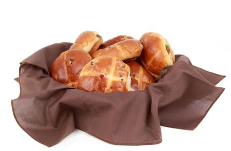 hot cross buns in a basket, white background
