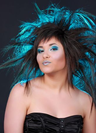 girl with blue light in her hair Banco de Imagens