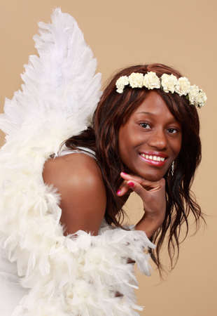 fake smile: beautiful african woman with fake wings and  flower crown