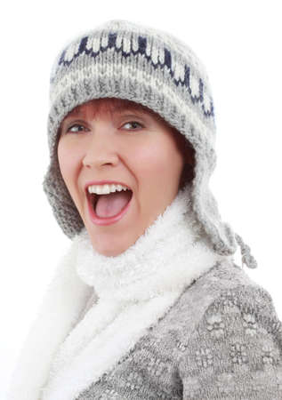 caucasian woman wearing a winter hat and scarf, white background photo
