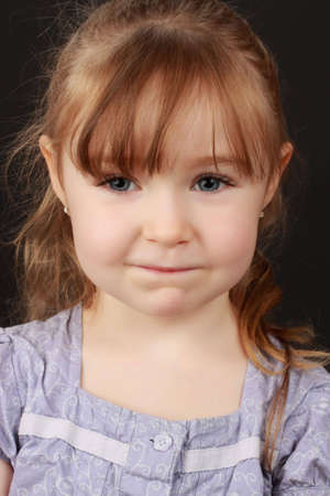 cute caucasian little blond girl, black background Stock Photo - 5813243