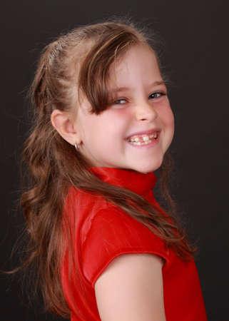 cute caucasian little blond girl, black background Stock Photo - 5829936