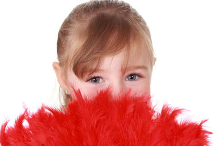 cute little blond girl hiding behind red feathers photo