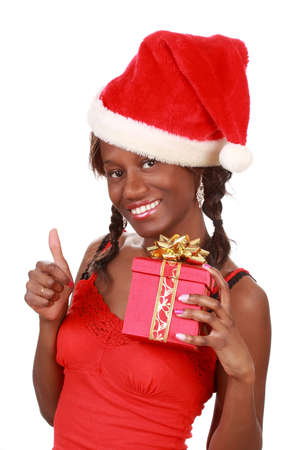 beautiful black woman holding a red xmas gift box photo
