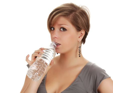 young blond woman drinking water in a plastic bottle photo