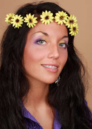 fake smile: beautiful young caucasian woman with fake flower in hair