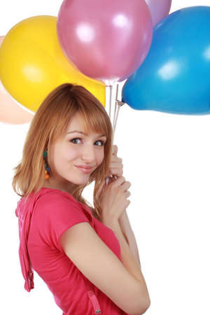 cute girl holding a bunch of colorful air balloon